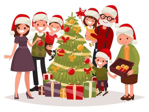 Gran familia feliz decora el árbol de navidad.