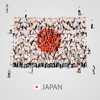Gran grupo de personas en forma de bandera de japón