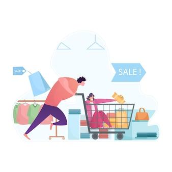 Gran venta con carrito de compras de empuje de hombre y mujer sosteniendo cajas