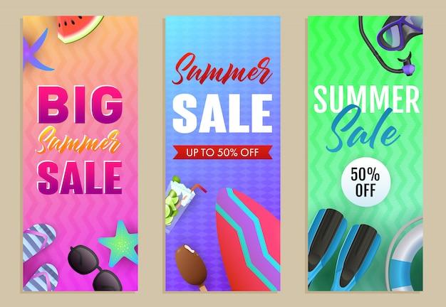 Grandes letras de venta de verano con tabla de surf y máscara de buceo