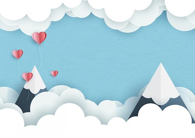 Grandes montañas con pequeños corazones y espacio para textos en nubes blancas sobre fondo azul.