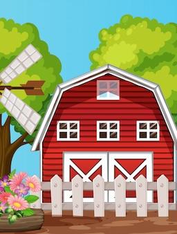 Granja en escena de la naturaleza con granero y molino de viento