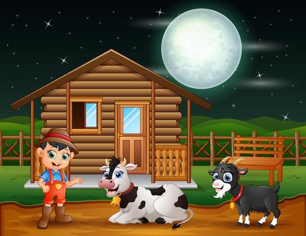 Granjero y animal de granja en el corral por la noche.