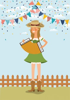 Granjero de sexo femenino que juega el acordeón con las guirnaldas y la cerca