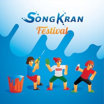 Grupo de adolescentes bailando en el festival de songkran.