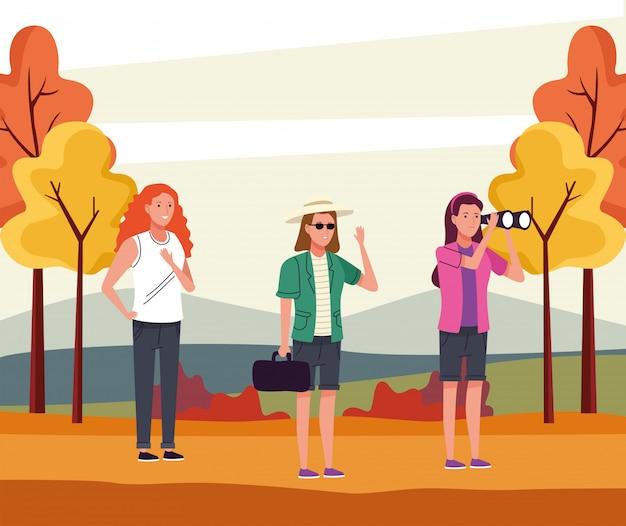 Grupo de chicas turísticas haciendo actividades en el paisaje otoñal.
