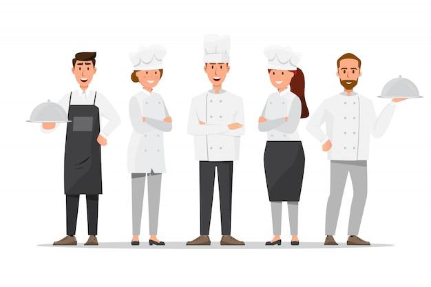 Grupo de cocineros profesionales, chefs de hombre y mujer.