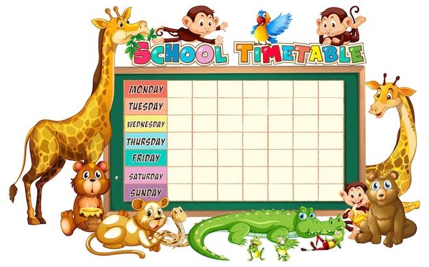 Grupo diverso de animales alrededor del planificador de horarios escolares