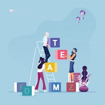 Grupo de empresarios con caja cúbica con la palabra equipo