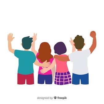 Grupo de gente joven dándose un abrazo