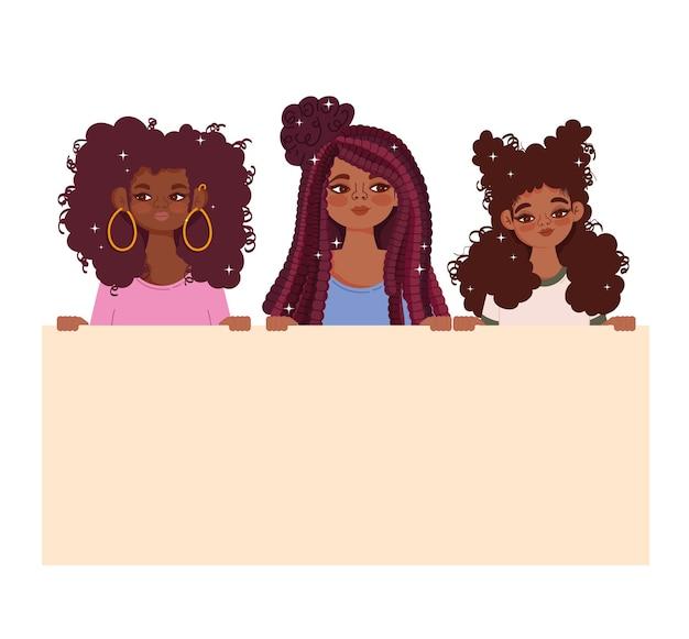Grupo de hermosas mujeres jóvenes afro con letrero