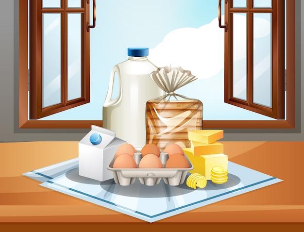 Grupo de ingredientes para hornear como huevos y mantequilla de leche en la ventana