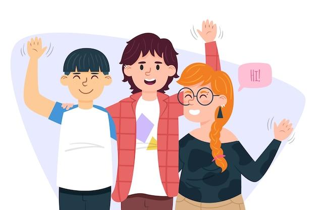 Grupo de jóvenes agitando la mano
