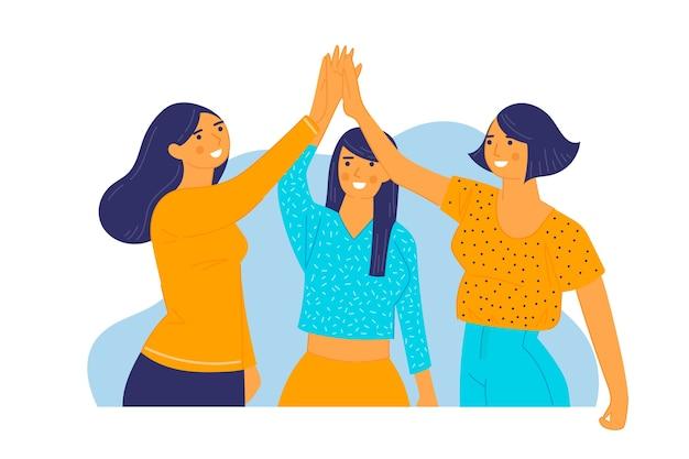 Grupo de jóvenes amigos dando cinco