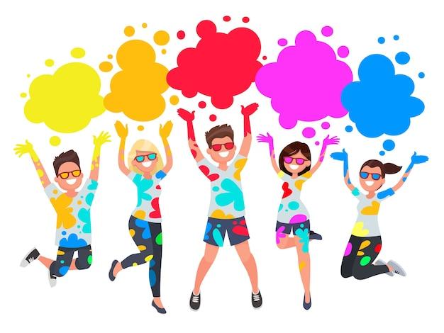 Grupo de jóvenes celebra noli. hombres y mujeres tiran pintura de colores.