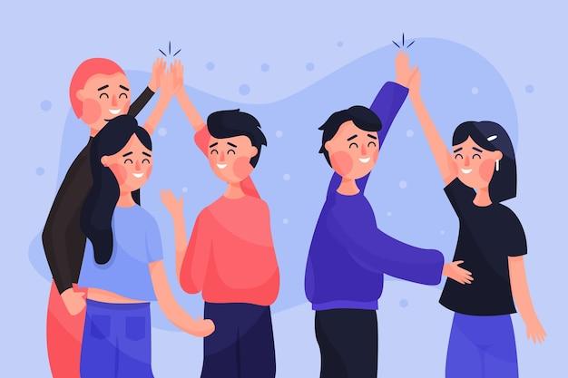 Grupo de jóvenes dando cinco