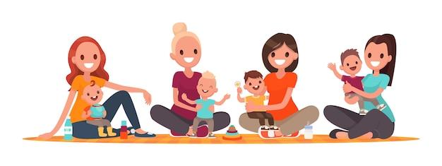 Grupo de madres con bebés. club de madres jóvenes. las mamás están sentadas con niños.