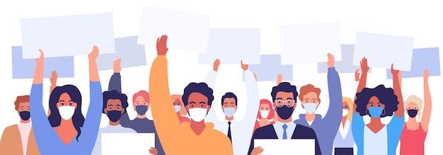 Un grupo de manifestantes con máscaras médicas sostienen carteles