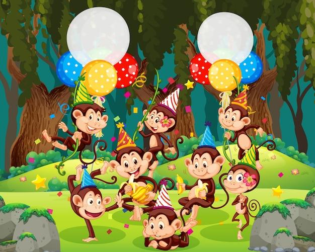 Grupo de monos en personaje de dibujos animados de tema de fiesta en el bosque
