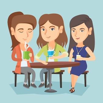Grupo de mujeres bebiendo bebidas calientes y alcohólicas.