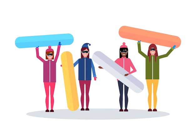 Grupo de mujeres con tabla de snowboard