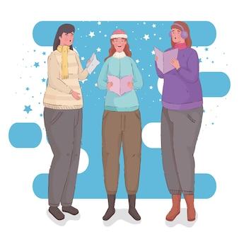 Grupo de mujeres vestidas con ropa de invierno cantando villancicos