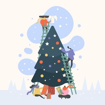 Grupo de personas decorando el árbol de navidad