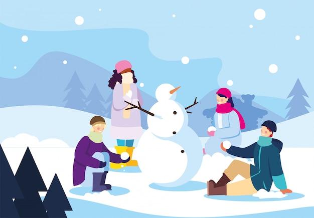 Grupo de personas con muñeco de nieve en el paisaje de invierno