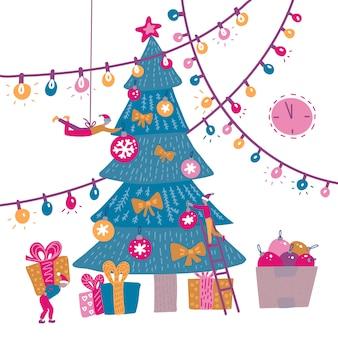 Grupo de personas pequeñas que decoran el árbol de navidad