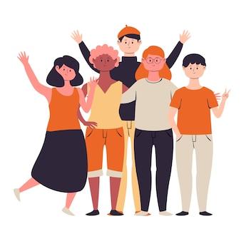 Grupo de personas posando y saludando