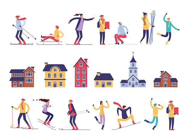 Grupo de personas practicando deportes de nieve y edificios.