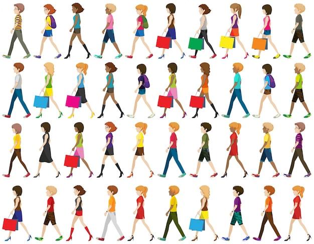 Grupo de personas sin rostro caminando sobre un fondo blanco