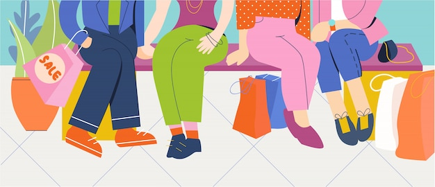 Grupo de personas se sientan en la tienda después de ir de compras.