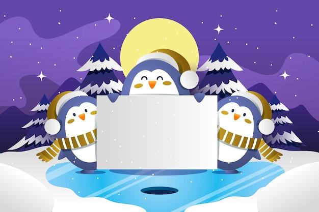 Grupo de pingüinos con banner de navidad