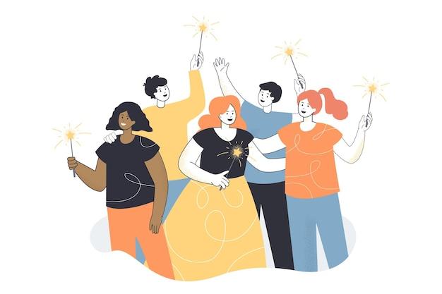 Grupo de trabajadores de oficina feliz de pie con luces de bengala en las manos