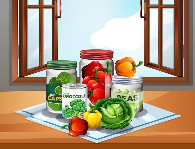 Grupo de verduras con verduras en frascos en el fondo de la ventana