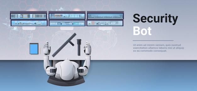 Guardia de seguridad robot mirando robot de pantalla de monitor