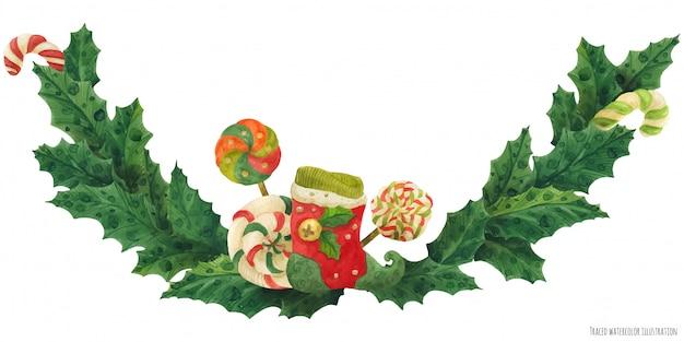 Guirnalda de acebo de navidad con medias y piruletas