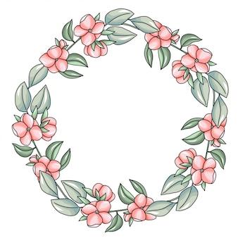 Guirnalda con flores rosas y ramas verdes.