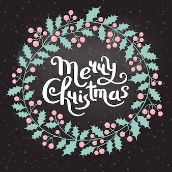 Guirnalda de navidad holly con la inscripción feliz navidad