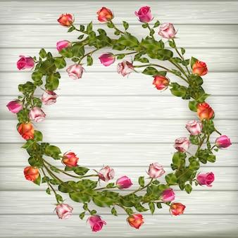 Guirnalda de rosas sobre fondo de madera. archivo incluido