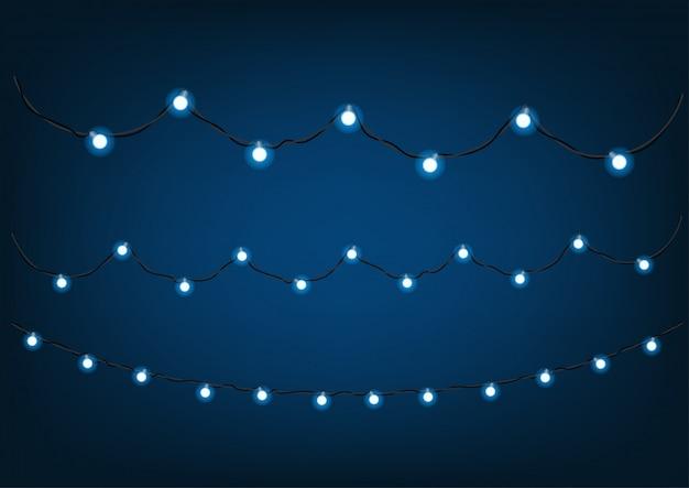 Guirnaldas azules sobre fondo oscuro. clipart vectorial