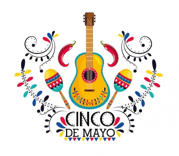 Guitarra mexicana con maracas y chiles.