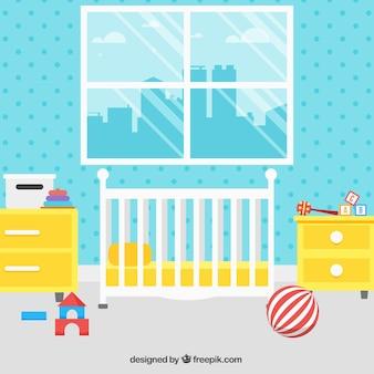 Habitación de bebé bonita con muebles amarillos y pared azul