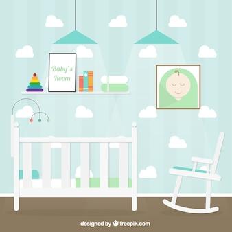 Habitación de bebé con nubes en la pared