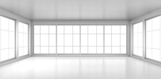 Habitación blanca vacía con grandes ventanales