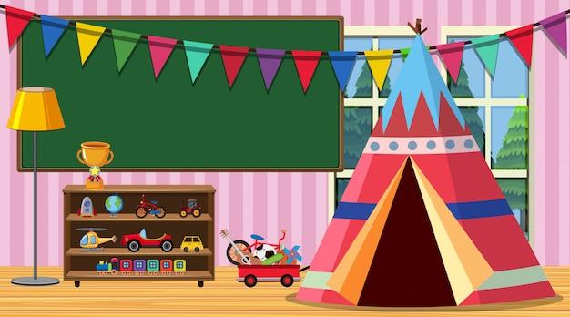Habitación infantil con pizarra y juguetes junto a la carpa