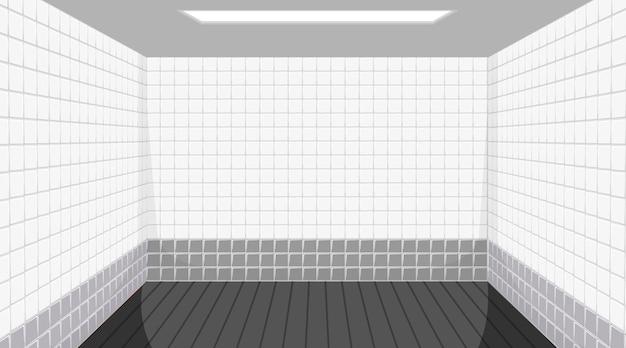 Habitación vacía con piso negro y paredes de azulejos blancos.