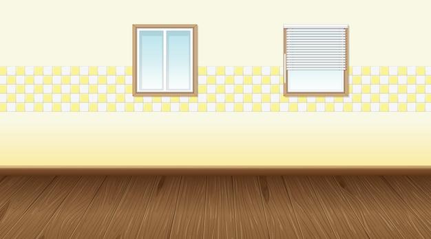 Habitación vacía con piso de parquet y papel tapiz amarillo