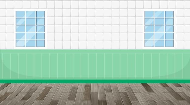 Habitación vacía con suelo de parquet y pared de azulejos verdes blancos